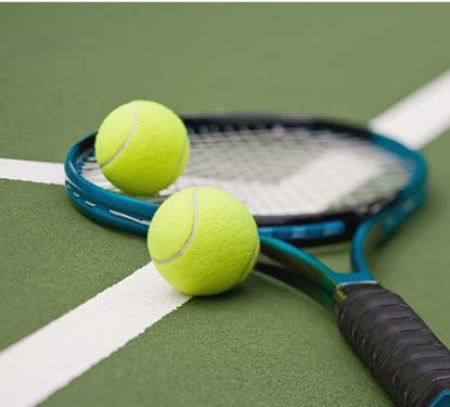 Photo of Tennis Racquet and balls
